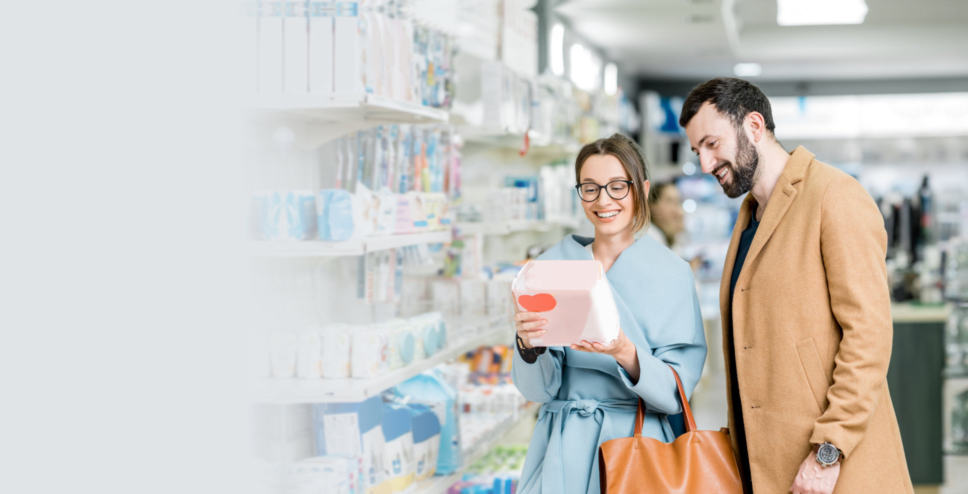couple buying at a pharmacy