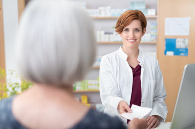 woman and a pharmacist in a pharmacy